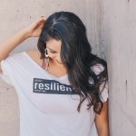 Woman with t-shirt and resilient logo